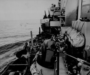 U.S. Navy gun crews cover landing on Mindoro Island, 1944 image from U.S. National Archives