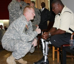 Lt. Col. Greg Gadson, who lost both legs in an IED attack in Iraq in 2007, shares a moment with fellow artilleryman, Capt. David Evetts, commander of Battery D, 1st Battalion, 77th Field Artillery Regiment, at the Ledward Theater, Sept. 29.