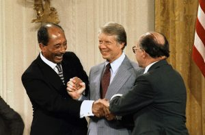 Anwar Sadat, Jimmy Carter, and Menahem Begin at Camp David Accords Image from US National Archives, public domain.