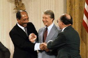 Anwar Sadat, Jimmy Carter, and Menahem Begin at Camp David Accords Image from US National Archives, public domain.