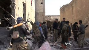 Kurdish YPG fighting in Kobane, Feb. 4, 2015. Image by Voice of America, wikimedia commons.