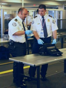 """Two by two, hands of blue."" ~Firefly TSA agents in Boston. Image by DHS, public domain."