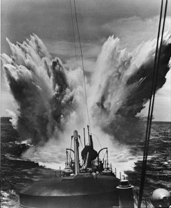 Depth charge explosion, c. 1943. Note merchant ship on left horizon. Image at Library of Congress, public domain.