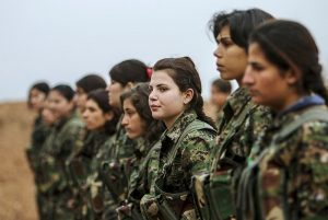 "Kurdish YPG fighters -- nobody's ""girls."" Image by About SLIMANY, wikimedia commons."