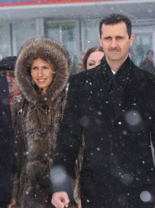 Dictator Bashar and wife Asmaa al-Assad in Moscow, March 26, 2008. Image by Ammar Abd Rabbo, wikimedia commons.