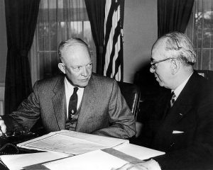 President Dwight D. Eisenhower receives hydrogen bomb tests report from Lewis Strauss Image public domain.