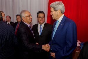 Malaysian P.M. Razak and US Secy. of State Kerry Image by US State Dept., public domain
