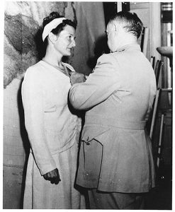 Virginia Hall receiving Distinguished Service Cross from OSS Gen. William Donovan, 1945 Image by US Govt., public domain.